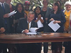 San Diego Mayor Bob Filner signs the Property Value Protection Ordinance into law.