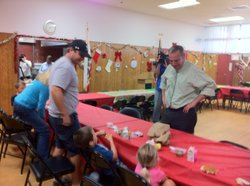 San Diego Mayor Bob Filner talks with kids and parents eating lunch at the Tierrasanta Recreation Center, Dec. 19, 2012.