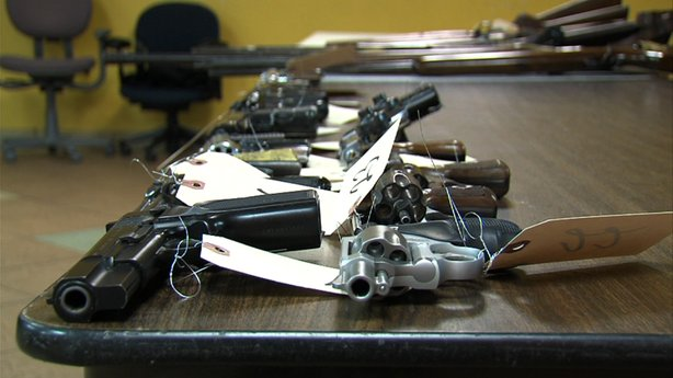 Handguns collected during the Guns For Gift Cards exchange on Dec. 21, 2012.