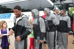 Members of the Baylor Bears football team get off the bus as they spend an afternoon visiting the San Diego Zoo. Baylor and UCLA play in this year&#39;s Holiday Bowl. 