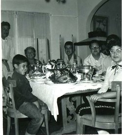 The Porras family, circa 1950, sitting at the dinner table for a holiday meal, the boy in the foreground is Margo's late father.