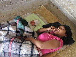 A young mother and her newborn rest in the village of Tlatquiltzingo in the southern Mexican state of Guerrero. 