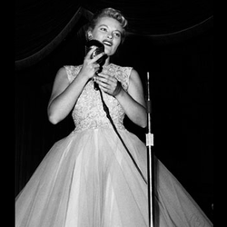 Singer Patti Page performing in 1957.