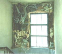 A low-res photo taken before the Alice in Wonderland mural was painted over in the 1980s.
