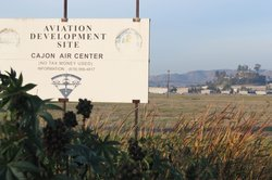 A sign also marks the land slated for redevelopment where the El Cajon Speedway once stood.