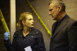 "DS Annie Cabbot (Andrea Lowe) and DCI Banks (Stephen Tompkinson) talk in the cellar in ""Aftermath."""