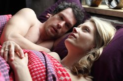"Mark Keane (John Light) and Annie Cabbot (Andrea Lowe) in bed in ""Playing With Fire."""