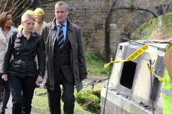 "Annie Cabbot (Andrea Lowe) and Banks (Stephen Tompkinson) in ""Playing With Fire."""