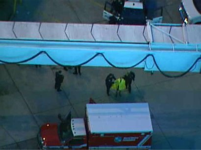 Man seen running across Lindbergh Field runway taken to ambulance.