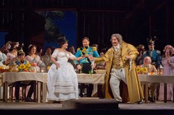 "Anna Netrebko as Adina, Mariusz Kwiecien as Sergeant Belcore, and Ambrogio Maestri as Doctor Dulcamara in Donizetti's ""L'Elisir d'Amore."""