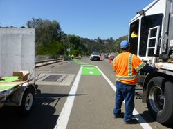 City of San Diego road crews painted a diagonal path on Montezuma Road to help bikes cross a fast-moving turn lane near the corner of Collwood.