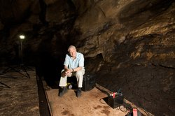 David Attenborough with filming equipment in Goamantong cave, Sabah, Borneo. Showing camera technology that allows us to film in the dark.
