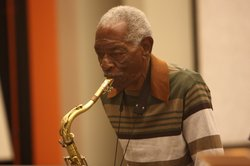 Daniel Jackson playing tenor saxophone. Jackson also writes original jazz compositions. 