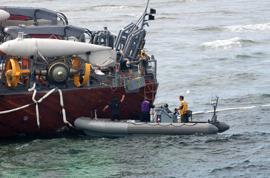 U.S. Navy removes harmful material from USS Guardian.