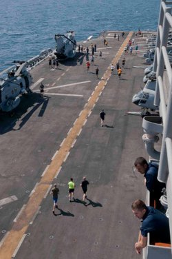 "Sailors and Marines aboard amphibious assault ship USS Peleliu (LHA 5) run in a 5K ""Turkey Trot"" on November 22, 2012."