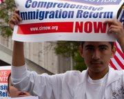 "A young man rallies for comprehensive immigration reform in 2010. <a href=""http://www.flickr.com/photos/dick_morgan/4577440300/"">Photo by Richard Morgan</a>"