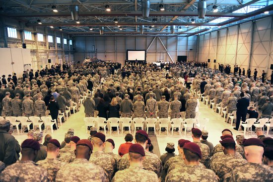 A memorial service for Maj. Lucas Gruenther is held in a hangar on Aviano Air Base, Italy, Feb. 6, 2013.