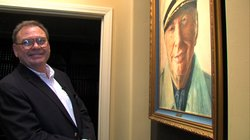 Marsh stands in front of one of his many paintings of L. Ron Hubbard, the founder of Scientology and the central figure in Marsh's multimillion dollar science fiction collection.