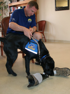 Army Major David Rozelle is an amputee who works with his Canine Companion Domi.