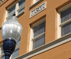 The Mason is a turn-of-the-century apartment building of approximately 17,740 square feet, located at the corner of Fifth Avenue and Ash Street.