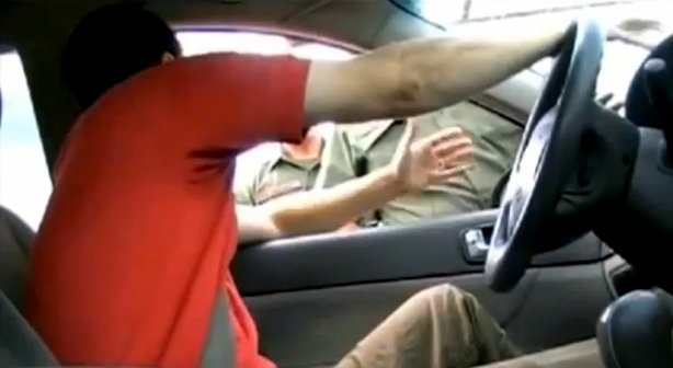 "When a driver approaches a Border Patrol checkpoint, the drill is to pull off the highway, wait in line, and then a Border Patrol agent will ask, ""Are you an American citizen?"" This driver refuses to answer the question. Credit: Screen grab from YouTube video: ""Top DHS check point refusals"""