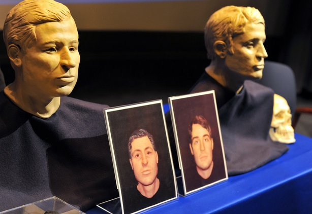 The facial reconstruction of the two USS Monitor Sailors whose remains were discovered inside the gun turret of the ship are revealed during a ceremony sponsored by the U.S. Navy Memorial Foundation, March 6, 2012.