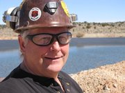 Donn Pillmore, director of Arizona Strip Operations for Energy Fuels Resources, stands in front of the containment pond.