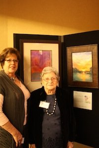 Community artist Natalie Sabin Gore with artist and Alzheimer's patient Barbara and their paired art.
