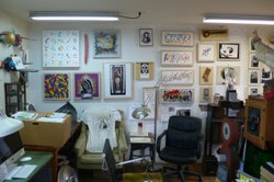 Just one wall of Matheny&#39;s studio. The wall of his home and studio showcase an extensive art collection. 