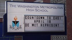The DC CAS Sign outside Washington Metropolitan High School (DC Met).