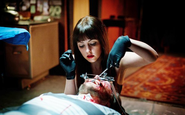"Mary (Katherine Isabelle) performing some non-elective surgery in ""American Mary."""