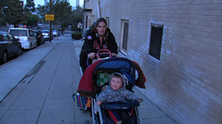 Christy Riddle pushes her 9-month-old baby, Charlie, in his stroller from the Rescue Mission Emergency Shelter.