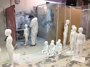 A factory worker in Ciudad Juarez spray paints mannequins that will ship to retail stores throughout the United States.