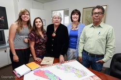 Orrantia and her colleagues at Tribal Start review a map of the American Indian populations of California.