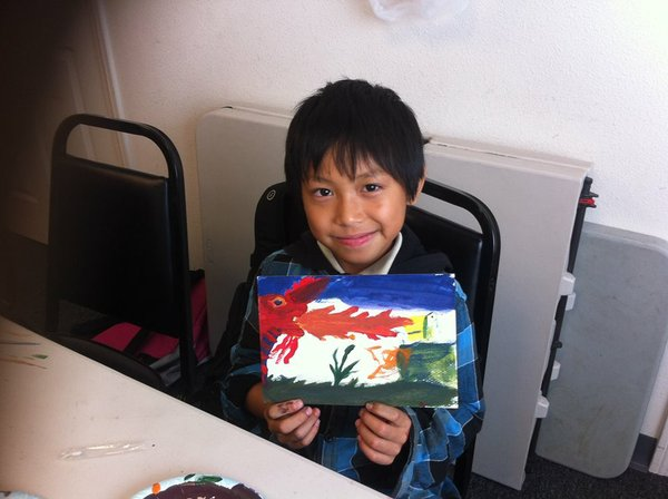 Saw is a young Burmese refugee, he painted a dragon at Karen Organization San Diego's after school program.