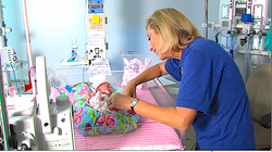 Volunteer Valerie Kalas spends five hours a week cuddling premature and sick babies. Research shows the beneficial effects of close personal contact can be seen 10 years later.