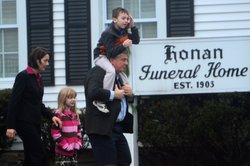 Mourners leave the Honan funeral home after attending the funeral of Jack Pinto, 6, one of the victims of the Sandy Hook Elementary School shootings, in Newtown, Conn.
