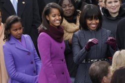 First lady Michelle Obama and her daughters Malia (center) and Sasha arrive for the swearing-in of President Obama at the Capitol.