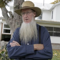 Amish bishop Sam Mullet stands in front of his home in Bergholz, Ohio. He was found guilty of masterminding a plan to cut off beards and hair of other Amish parishioners.