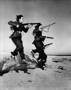"Female members of Egypt's ""liberation battalions"" train in the desert near Cairo for guerrilla warfare against the British in the Suez Canal zone, Nov. 20, 1951."