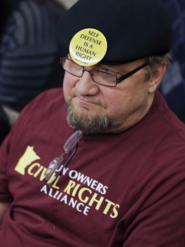 Gun rights advocate Andy Cers of Minneapolis listens to testimony during a Minnesota House hearing on bills dealing with gun violence on Tuesday in St. Paul.