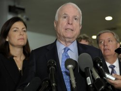 Sen. John McCain, R-Ariz., Sen. Kelly Ayotte, R-N.H., left, and Sen. Lindsey Graham, R-S.C., right, speak Tuesday after a meeting with U.N. Ambassador Susan Rice.