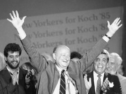 New York Mayor Ed Koch raises his arms in victory on Sept. 11, 1985, after winning the Democratic primary in his bid for a third four-year term.