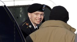 Army Pfc. Bradley Manning (center) is escorted into the courthouse on Nov. 28.