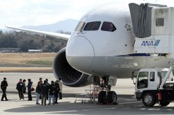 National Transportation Safety Board investigators inspect a Boeing 787 Dreamliner at Japan's Takamatsu Airport. A Federal Aviation Administration investigation into the plane's troubles has widened into a review of the agency's certification process for new airliners.