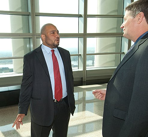 Porter was hired by Chief U.S. Probation Officer Douglas Burris, right, who was initially taken aback by the proposal of ex-felon Porter working for the probation office.