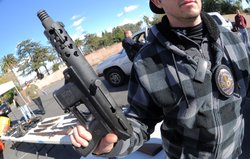 A police officer held an assault weapon turned in during a gun buyback in the Van Nuys area of north Los Angeles on Dec. 26.
