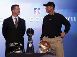 San Francisco 49ers head coach Jim Harbaugh (right) and his brother, Baltimore Ravens head coach John Harbaugh, with the Vince Lombardi Trophy on Friday.