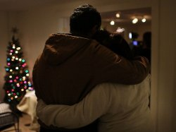 Hanging on to each other: Two people at one of the prayer services Friday night in Newtown, Conn.