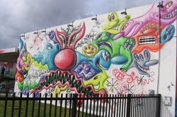 Los Angeles artist Kenny Scharf&#39;s cartoon-like mural greets visitors to Wynnwood Walls.